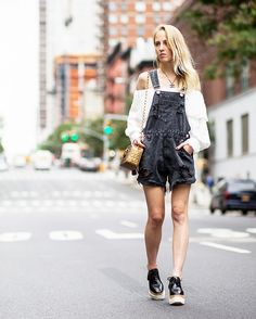 Overalls layered over an off-the-shoulder top worn with Stella McCartney platform oxfords.