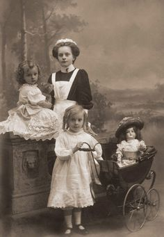 """This photographic image from The Grovian's collection illustrates an English governess who appears to be not much older than her charges. This rare photo was taken just before World War I, a conflict that not only changed the world of service forever, but also marked for the governess, and most domestic servants, the end of an era. Learn why in """"The Governess - A Life Lived Up and Down the Stairs."""" http://www.carmeldollshop.com/images/canadaspdfs/governess2.pdf"""