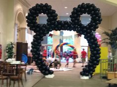 Mickey Mouse arch with a Rainbow arch in the middle for an awesome cause Project Zero helping all parentless children in Arkansas find forever homes!!!