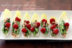 Raspberry, asparagus, candied pecan endive spears. Easy entertaining recipe.