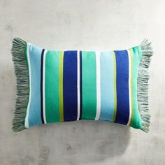Stripes, fringe and comfort aplenty—our cool-toned indoor/outdoor pillow adds a beachy look to any space.