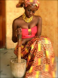African woman cooking.