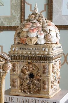 Fancy birdhouse, I mean bird palace, covered with shells!  Lucky birdies!