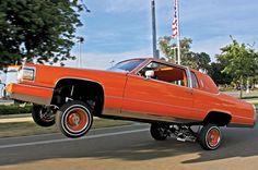 #90doutlac #gashopping #lowrider #lowriders #lowridermagazine #hydraulics #hydros #orange #individualscc