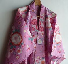 This is a cotton kimono called yukata. Yukata is summer time casual kimono. Cherry blossom pattern is printed. Flower petals are outlined with