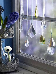 Great idea for old chandelier crystals. ...just like my kitchen window . . so beautiful when the sun comes round :0)