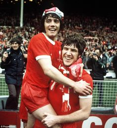 Up for the Cup! Kevin Keegan (left) celebrates with Emlyn Hughes after Liverpool beat Newcastle 3-0 to win the Cup in 1974