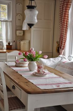 Stick with the red and white theme for kitchen roman shades, etc. Transfer ware and iron ware collection will look so perfect with this. House needs this fun pop of color, and the kitchen is the best place for it.