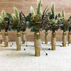 We get so excited when we're asked to do off beat things, these bullet casing boutonnieres are so cool. Bullet Boutonniere, Shotgun Shell Boutonniere, Diy Boutonniere, Diy Wedding Flowers, Diy Wedding Decorations, Flower Bouquet Wedding, Floral Wedding, Bridal Bouquets, Wedding Centerpieces