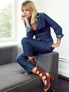 Walkabout Chambray One Piece   Lightweight chambray jumpsuit with V-neckline and hidden button placket. Four-pocket style with waist tie accent.