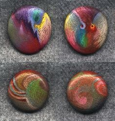 colored pencil on rocks!  (looks like dichroic glass!)