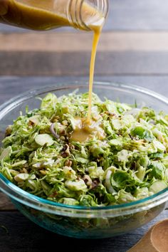 Shaved Brussels Sprout Salad with Apples and Walnuts -   Trim the ends off the Brussels sprouts. Using a sharp knife OR using the thinest blade on a mandoline slicer (and a no cut glove) slice each sprout thinly. Slice the apple and red onion in the same manner. Combine in a large bowl.