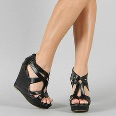 Black Warner wedges from Jourdan's Jewels. Just $25. They are very comfy to walk in with the thick platform. Zip up in the back.