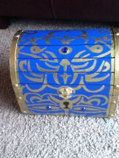 Ok so - we'd have a locked treasure chest (see picture). To unlock it, there would be a series of puzzles a team of people have to solve in order to get the key. So, if you have 2 teams, and 2 sets of each puzzle, or something. puzzles or challenges.Or maybe we can have the key hiding in one of those balloons mentioned before!