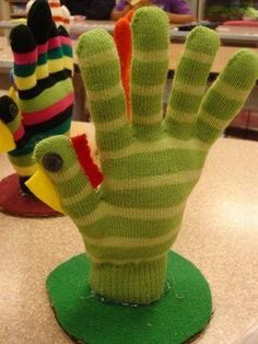 How cute is this for Thanksgiving? A hand turkey you can make with old gloves (because who doesn't have a mate-less mitten hanging around when you have kids? ) http://thestir.cafemom.com/toddler/112504/10_thanksgiving_crafts_from_moms?utm_medium=sm&utm_source=pinterest&utm_content=thestir