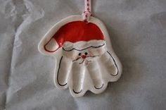 Salt Dough Santa Handprint Ornaments: 1/2 cup salt, 1/2 cup flour, 1/4 water (give or take), knead until dough forms. Make impression and cut out hand shape with a knife leaving a border. Poke a hole in the top for hanging. Bake at 200F for 3 hours. Paint, seal and ready to hang :)