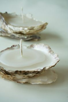 Beautiful oyster shell candles, all made from two oyster shells fitted together. They are secured at just the right point to balance each others weight and become a small delicate stand alone sculpture. The shells were found on the shores of Galway Bay in Ireland, complete with various crustations. They have been cleaned with the dormant crustrations left intact to add to the organic feel of the candles. The set of three white candles are vannila scented and have a burning time of…