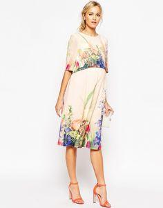 Maternity: Vibrant florals, graceful drape.