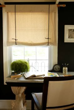 painters drop cloth/burlap and dark ties make for very cool/economical Roman shades!
