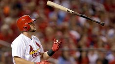 St. Louis Cardinals' Matt Adams flips his bat after striking out swinging to end the sixth inning of a baseball game against the Chicago Cubs, Wednesday, May 6, 2015, in St. Louis. (AP Photo/Jeff Roberson)