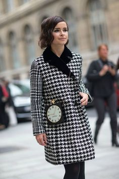 Shop Miroslava Duma's look for $172:  http://lookastic.com/women/looks/black-and-white-overcoat-and-black-crossbody-bag-and-black-tights/1385  — Black and White Houndstooth Overcoat  — Black Embellished Crossbody Bag  — Black Tights