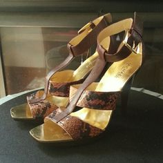 """Michael Kors Gold and Snake skin Stilettos Gorgeous Michael Michael Kors heels, gold insole, snake skin look, straps around the ankle, brown leather and gold accents. 4.75"""" heel. MICHAEL Michael Kors Shoes Heels"""