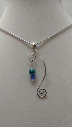 5mm crystal pearl and 3mm crystal bicone dangle on a hand formed fine silver wire pendant ~ made by Arrion Wright  #handmade #jewelry