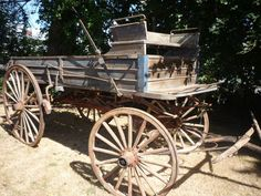 Antique Wooden Wheeled Horse Drawn Wagon Buckboard Mail Wagon Stored Under Cover