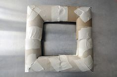 A practically free DIY square wreath form from toilet paper rolls. Now just add material, ribbon, flowers or anything else you may want!