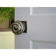Rustic solid pewter door knobs with a modern touch.