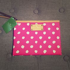 HPx4 Kate Spade wristlet Authentic Kate Spade wristlet, NWT. Super cute polka dots! Measures 6x8 inches. VERY faint marks (as shown in picture). Marks were there when clutch was purchased. Two small inner pockets. No dust bag. NO trades please! kate spade Bags Clutches & Wristlets