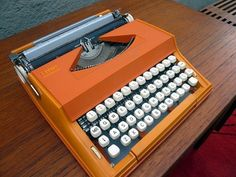 Olivetti type writer in my fave colour. I want it!