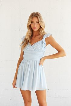 Feeling femme in the Desiree Ruffle Mini Dress! This charming piece features a wrap sweetheart neckline, a tie detail at the waist, and a flouncy hem to complete this flowy silhouette. Available in blue, sage, and white. Top this dreamy look off with the Five and Two Rogue Necklace and you'll be set for your next spring occasion! Sorority Recruitment Outfits, Sorority Rush, White Flowy Dress, Ruffle Dress, Rush Dresses, Blue Dresses, Character Reference, Size Model, Sage