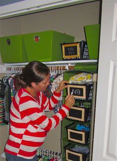 Place plastic storage bins inside a hanging sweater organizer! Paint end with chalkboard paint for easy labeling. When baby is older they can be used for toy storage! - DIY - nursery inspiration (good idea if you have more closet space then floor space)