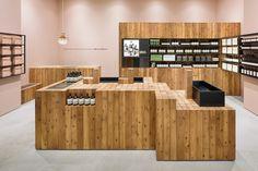 torafu architects warm aesop grand front osaka shop with japanese cedar