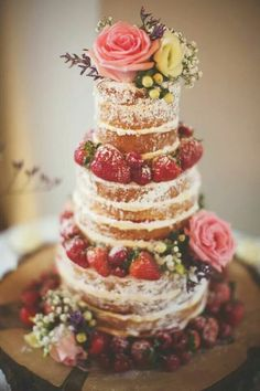 Seasonal fruit and flowers adorn this naked wedding cake. Mrs. Patmore and Daisy would love to make this for any of the Downton Abbey ladies. | Masterpiece PBS