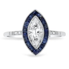 The Baylor Ring. 1920's. 18K White Gold. Center - 0.71 ct. marquise cut diamond, H color, VS1 clarity. Sidestones - Nineteen French cut natural sapphire accents, dark blue color, eye clean clarity, approx. 0.59 ctw.; Six old European cut diamond accents, F/G color, SI1 clarity, approx. 0.03 ctw.