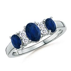 Love this Jewelry Style from Angara! Three Stone Blue Sapphire Ring With Diamond Accents Anniversary Bands For Her, Diamond Anniversary, Dream Engagement Rings, Blue Sapphire Rings, Three Stone Rings, Ring Designs, Gemstone Jewelry, Diamonds, Nice Jewelry