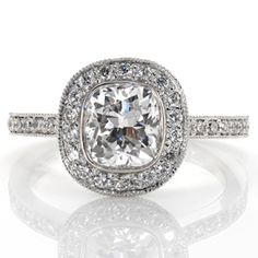 This beautiful diamond engagement ring has a narrow band and clean lines. The band and halo are both done in micro pave around the bezel set, cushion cut center diamond. Design 2251 from Knox Jewelers
