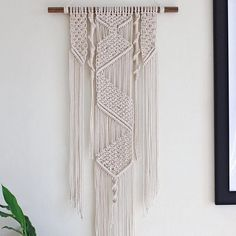 A strong and calming piece, be the owner of this one of a kind Macramé feature wall hanging. Measuring 91cm wide x 80cm height from hook to bottom.