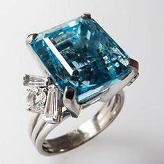 Vintage 13 carat aquamarine cocktail ring with diamonds in 14K white gold.