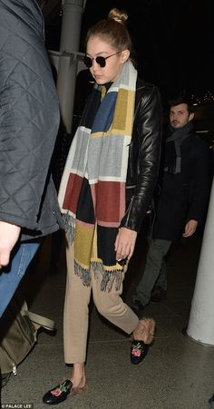 Striking:Gigi added to her relaxed look with a pair of distinctive floral emblazoned loafers with  fur lining