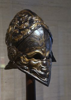 The Morosini Helmet (visored burgonet) probably 1550/1560 repoussé and embossed iron or steel, with gilding and silvering