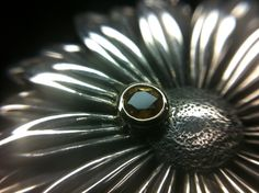 Silver daisy with yellow sapphire set in yellow gold. Daisy, Sapphire, Gemstone Rings, Silver Rings, Gemstones, Jewellery, Yellow, Gold