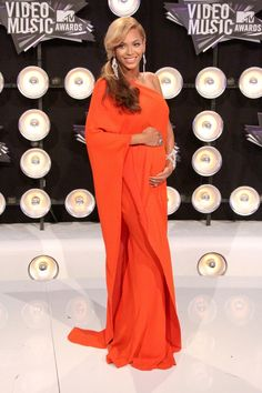 Wearing maternity style, Beyonce looks stunning in a draped Lanvin dress in orange in 2011. Photo: Andrew Evans / PR Photos