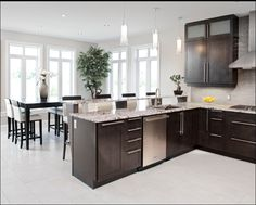 Love this open and modern kitchen design created by Laurysen Kitchens Ltd. It looks so clean and peaceful. The ET2 Frost Pendant lighting fixtures are one of my favorite pieces in this space.