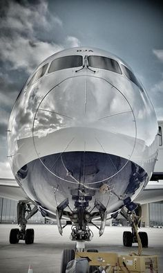 HDR shot of a Boeing 787 Dreamliner's nose with light clouds
