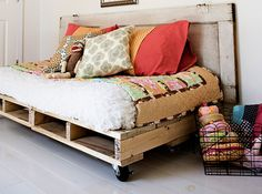 Pallet platform bed.  Painted white to match the crib.  Mattress on the floor solution for booting all the kids upstairs.