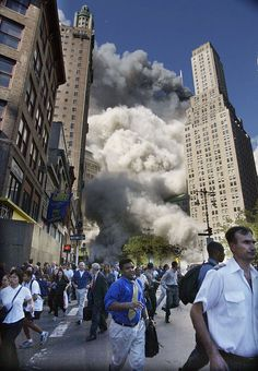 On the Run    Downtown office workers flee the clowds of smoke that swirled through the streets of lower Manhattan when the towers crumbled.