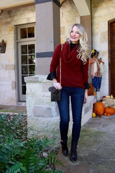 Layering a bell sleeve top under a cashmere burgundy sweater with dark wash skinny jeans and black ankle boots